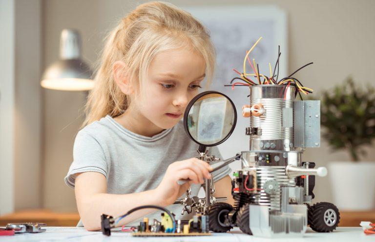 Little girl making robot